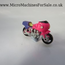 Ducati 1000 (pink & purple, yellow figure)