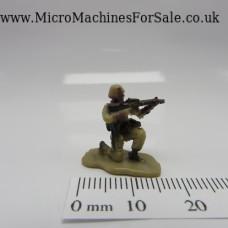 Kneeling machine gunner soldier